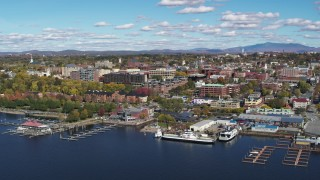 DX0002_224_011 - 5.7K stock footage aerial video reverse view of downtown buildings and marinas, Burlington, Vermont