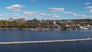 DX0002_224_015 - 5.7K stock footage aerial video fly low over breakwaters toward downtown, Burlington, Vermont