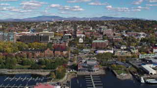 DX0002_224_018 - 5.7K stock footage aerial video ascend from marina for view of city buildings and College Street, Burlington, Vermont