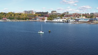 DX0002_224_024 - 5.7K stock footage aerial video of orbiting a sailboat on Lake Champlain, reveal downtown, Burlington, Vermont