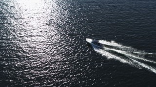 DX0002_224_025 - 5.7K stock footage aerial video of tracking a speedboat racing across Lake Champlain near Burlington, Vermont