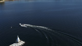 DX0002_224_027 - 5.7K stock footage aerial video of tracking a speedboat racing around a lighthouse on Lake Champlain near Burlington, Vermont