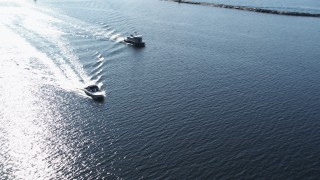 DX0002_224_030 - 5.7K stock footage aerial video orbit a speedboat near another boat on Lake Champlain near Burlington, Vermont