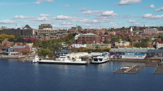 DX0002_224_033 - 5.7K stock footage aerial video orbit office building in downtown, seen from marina, Burlington, Vermont