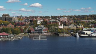 DX0002_224_034 - 5.7K stock footage aerial video orbit office building in downtown, seen from a marina, Burlington, Vermont