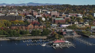 DX0002_224_035 - 5.7K stock footage aerial video wide orbit office building in downtown, seen from a marina, Burlington, Vermont