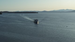 DX0002_224_042 - 5.7K stock footage aerial video tracking a ferry on Lake Champlain near Burlington, Vermont