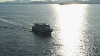 DX0002_224_043 - 5.7K stock footage aerial video tracking a ferry on Lake Champlain near the lighthouse in Burlington, Vermont