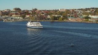 DX0002_224_045 - 5.7K stock footage aerial video orbit and approach a ferry on Lake Champlain, Burlington, Vermont