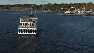 DX0002_224_046 - 5.7K stock footage aerial video orbit around a ferry on Lake Champlain, Burlington, Vermont