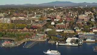 DX0002_224_048 - 5.7K stock footage aerial video of a wide orbit of city building near marinas in downtown, Burlington, Vermont