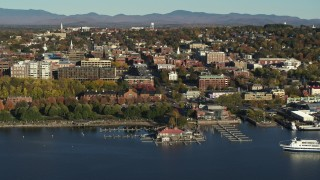 DX0002_224_049 - 5.7K stock footage aerial video of a wide orbit of city building near a marina in downtown, Burlington, Vermont
