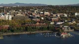 DX0002_224_050 - 5.7K stock footage aerial video approach park and city building near a marina in downtown, Burlington, Vermont