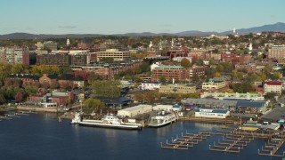 DX0002_224_052 - 5.7K stock footage aerial video orbit around two marinas and city buildings in downtown, Burlington, Vermont