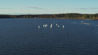 DX0002_224_055 - 5.7K stock footage aerial video flying away from and orbiting a group of sailboats on Lake Champlain, Burlington, Vermont