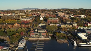 DX0002_224_058 - 5.7K stock footage aerial video of a reverse view of city buildings near marinas, Burlington, Vermont