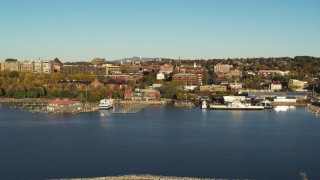 DX0002_224_059 - 5.7K stock footage aerial video of orbiting city buildings near marinas, seen from breakwater, Burlington, Vermont