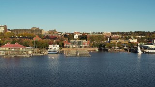 DX0002_224_062 - 5.7K stock footage aerial video of approach a marina and city buildings in downtown, Burlington, Vermont
