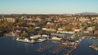 DX0002_224_068 - 5.7K stock footage aerial video descend toward marina and orbit downtown buildings, Burlington, Vermont