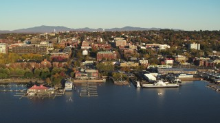 DX0002_224_069 - 5.7K stock footage aerial video orbit around downtown buildings and Lake Champlain marinas, Burlington, Vermont