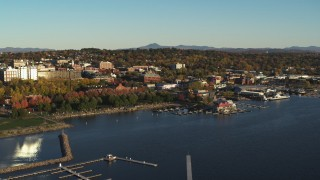DX0002_224_070 - 5.7K stock footage aerial video slowly orbit downtown buildings, Waterfront Park and Lake Champlain marina, Burlington, Vermont