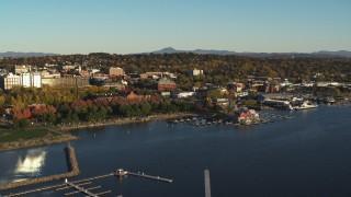 DX0002_224_070 - 5.7K stock footage aerial video slowly orbit downtown buildings, Waterfront Park and Lake Champlain marina, Burlington, Vermont