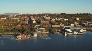 DX0002_224_071 - 5.7K stock footage aerial video orbit downtown buildings, Waterfront Park and Lake Champlain marinas, Burlington, Vermont
