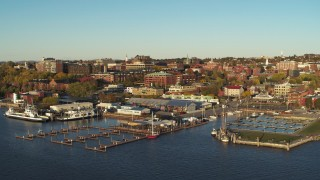 DX0002_224_073 - 5.7K stock footage aerial video an orbit of downtown buildings behind Lake Champlain marina, Burlington, Vermont