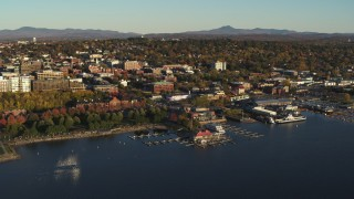 DX0002_224_074 - 5.7K stock footage aerial video an orbit of downtown's city buildings behind a Lake Champlain marina, Burlington, Vermont