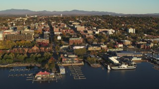 DX0002_224_075 - 5.7K stock footage aerial video of downtown's city buildings and marinas during approach to office building, Burlington, Vermont