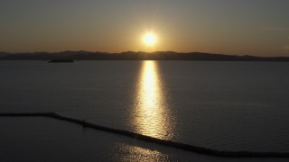 DX0002_225_001 - 5.7K stock footage aerial video setting sun reflecting off Lake Champlain, Burlington, Vermont