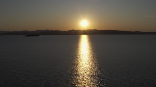 DX0002_225_002 - 5.7K stock footage aerial video setting sun reflecting off the surface of Lake Champlain, Burlington, Vermont