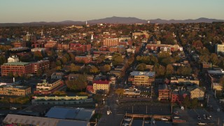 DX0002_225_004 - 5.7K stock footage aerial video fly over a marina toward downtown, Burlington, Vermont