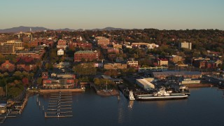 DX0002_225_006 - 5.7K stock footage aerial video of buildings in downtown, seen while passing the marinas, Burlington, Vermont