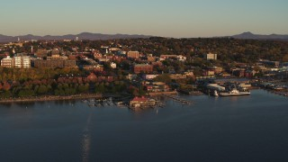 DX0002_225_007 - 5.7K stock footage aerial video of flying away from park, buildings in downtown, and a marina, Burlington, Vermont