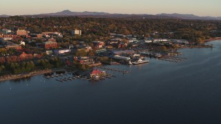 DX0002_225_009 - 5.7K stock footage aerial video ascend toward marinas and buildings in downtown at sunset, Burlington, Vermont