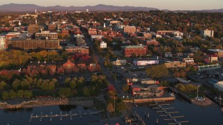 DX0002_225_010 - 5.7K stock footage aerial video orbit buildings in downtown at sunset, Burlington, Vermont