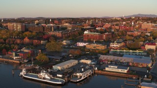 DX0002_225_011 - 5.7K stock footage aerial video orbit buildings in downtown and marina at sunset, Burlington, Vermont