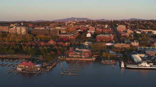 DX0002_225_015 - 5.7K stock footage aerial video fly over marina toward downtown at sunset, Burlington, Vermont
