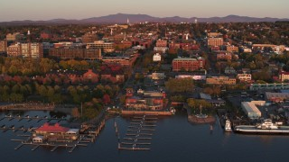 DX0002_225_016 - 5.7K stock footage aerial video fly away from downtown and a marina at sunset, Burlington, Vermont