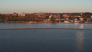 DX0002_225_017 - 5.7K stock footage aerial video fly away from downtown and Lake Champlain breakwater at sunset, Burlington, Vermont