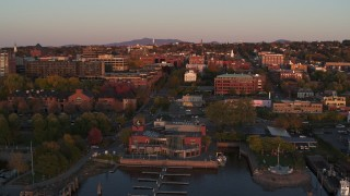 DX0002_225_019 - 5.7K stock footage aerial video a view of downtown at sunset, descend to reveal marina, Burlington, Vermont