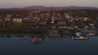DX0002_225_021 - 5.7K stock footage aerial video circling downtown and two marinas at sunset, Burlington, Vermont