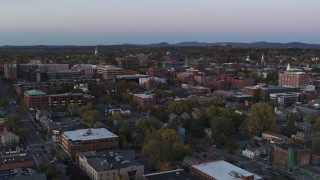 DX0002_225_026 - 5.7K stock footage aerial video flying over downtown office buildings at twilight, Burlington, Vermont