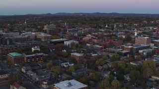 DX0002_225_027 - 5.7K stock footage aerial video flying away from downtown office buildings at twilight, Burlington, Vermont