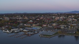 DX0002_225_028 - 5.7K stock footage aerial video of orbiting downtown buildings at twilight, reveal marina, Burlington, Vermont