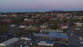 DX0002_225_031 - 5.7K stock footage aerial video of flying by downtown office buildings at twilight, Burlington, Vermont