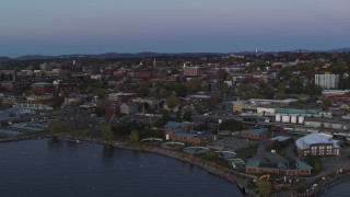 DX0002_225_032 - 5.7K stock footage aerial video reverse view of downtown buildings at twilight, Burlington, Vermont