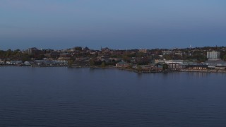 DX0002_225_037 - 5.7K stock footage aerial video slowly approach downtown buildings from the lake at twilight, Burlington, Vermont