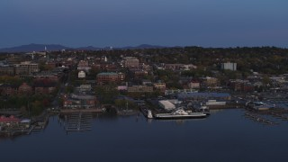 DX0002_225_040 - 5.7K stock footage aerial video of orbiting downtown and the lakeside marinas at twilight, Burlington, Vermont